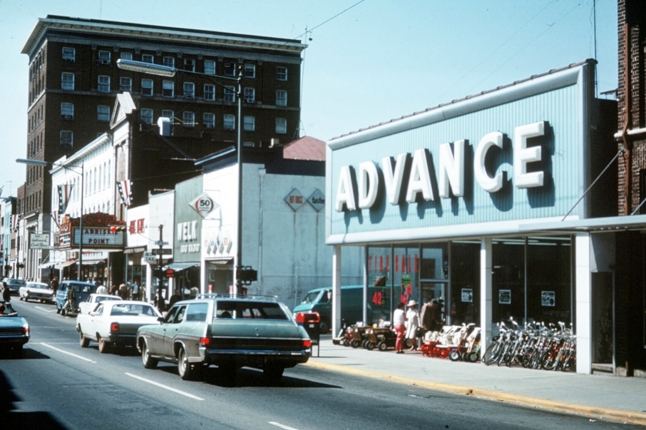 "In the years before the Downtown Mall was constructed Main Street had a different look -and many different businesses- than it has today.  The Advance store on the right (selling tillers and bikes in addition to auto parts) sat on the corner of Third and East Main where Vivians and Rapture are now. The Paramount Theater is seen down the street showing the 1970 film, ""Zabriskie Point"" just a few short years before it would close its doors for 3 decades. Also visible is a group of buildings to the west (left) of the Paramount that would be lost to fire in 1973. At this point in its history Main Street was a one-way street with traffic flowing west. -- Steve Trumbull"