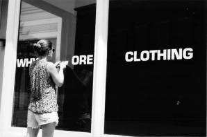 """Why Pay More Clothing"" (or ""Whore Clothing,"" as this shot would have it), going out of business. They were in the E. 200 block of West Main, I think immediate adjacent to what's now Mudhouse."