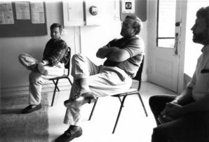 Lee Danielson and Colin Rolph, developers of the Ice Park and Regal theater, address a very skeptical Living Education Center student body (in the building that today houses The Whiskey Jar, on Old Preston Ave. at the west end of the Downtown Mall). Ernie Reed, at right, ran the school. The fall of 1995, I think?