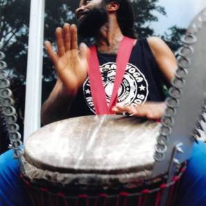Darrell Rose, drumming in front of Ujamaa Mart, at the corner of 3rd St. NE and Main.